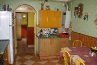 Eladó 70 m²-es házrész XX. Kerület (Pacsirta telep), kertvárosi utca: 19'900'000 Ft